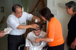 Chuxiong Huang performs papa's baptism.