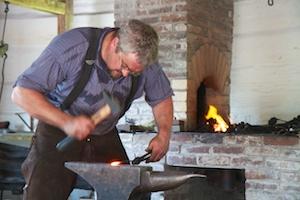 Blacksmith working the anvil